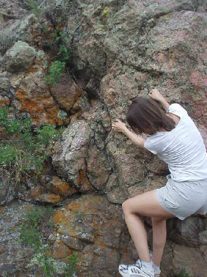 Kat was actually the one who got me into rock climbing 8 years ago.  Here she is inspecting a rock.