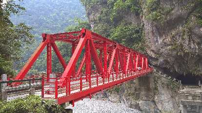 Red Changchung Bridge off Highway 8 near Taroko National Park in north Hualien County, Taiwan.