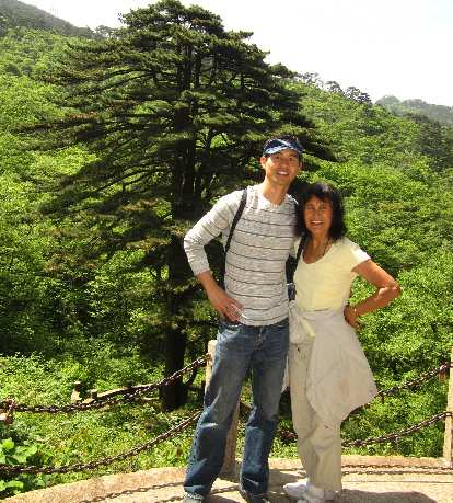 Me and my mom by a popular tree in the Huangshan Mountains.