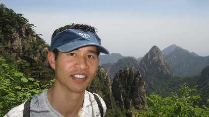 "Felix Wong in front of the ""five fingers"" in the Huangshan Mountains."