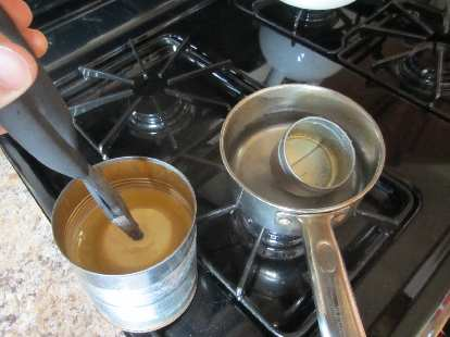I found a can of wax for $1 at the ARC thrift store that I wanted to use for a speedometer housing.  This involved removing the wax which I did by melting it in a pot of water on the stove.