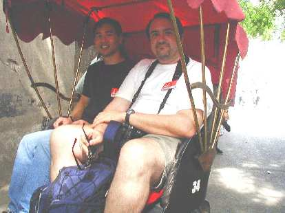 John and I readying ourselves for a ride in a rickshaw.