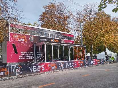 A small building at Prater Park adorned with INEOS logos and slogans.