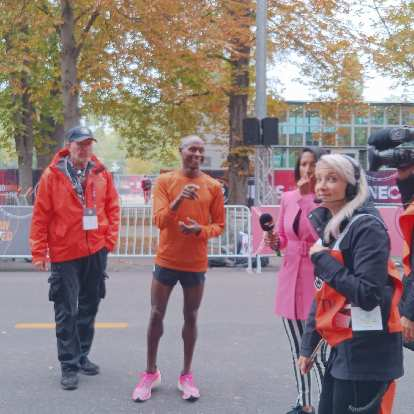 Legendary Bernard Lagat, holder of several middle-distance American records, was a pacer for Kipchoge and was interviewed after the race.