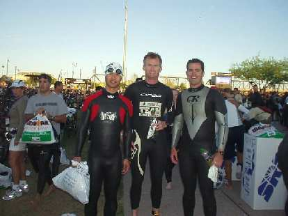Felix, Bob, and Josh, now suited up in wetsuits with the 7:00 a.m. race start getting closer.