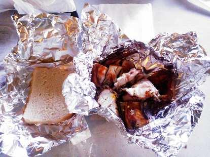 Wheat bread with jerk chicken.