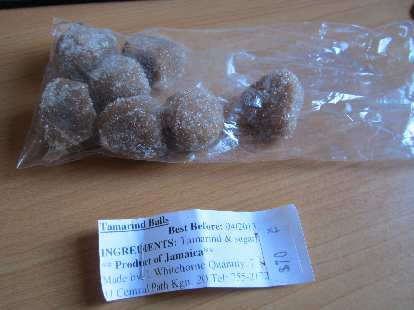 Tamarind balls with seeds inside.