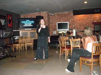 Bev singing a second song of three.