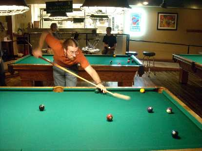 Jesse taking a pool shot at Coopersmith's.