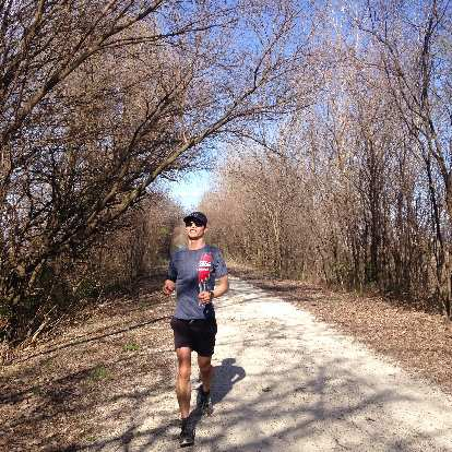 Felix Wong running on the Katy Trail northeast of St. Charles in late March 2016, before the trees had bloomed.