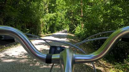 The view behind the handlebars of the rental bike on the Katy Trail.