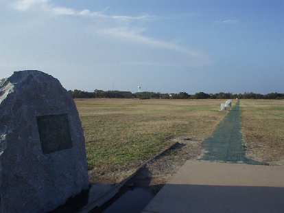 Down below and to the north of the monument are boulders demarking the beginning point of their first flights.  The boulders in the distance demark where they landed after successful Flight #1, 2, 3, and 4.