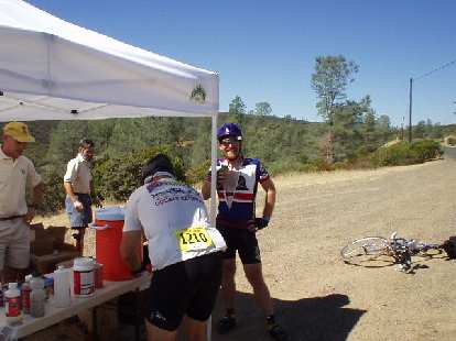 "Mile 94, 12:22 p.m.: My friend Adam Paulaul"", also from Fremont and a California Triple Crown winner, at the water stop."