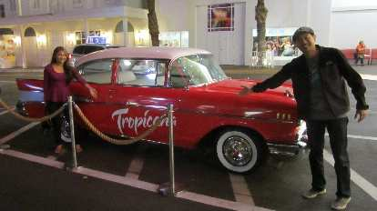 Sara and Bandy in front of a Chevy Bel Air in front of the Tropicana, the hotel we stayed at off the Strip.