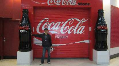 Felix Wong in front of the Coca-Cola store.