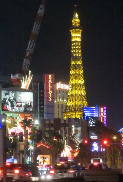 The faux Eiffel Tower in the Strip at night.