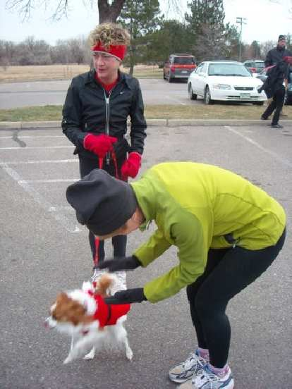 This little doggie dressed as Santa Claus ran this race.