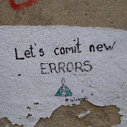 """""""Let's comit [sic] new errors""""---as seen on a wall in Alfama."""