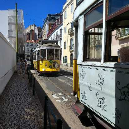 One of the cable cars that went through Alfama broke down, causing a back up of cable cars.  Everyone had to get out and walk.