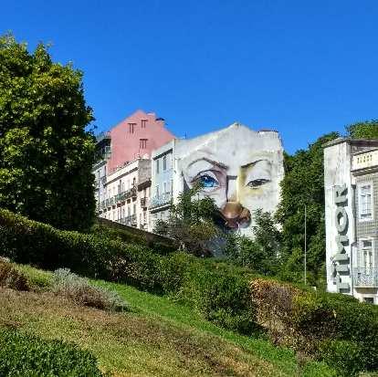 Mural of watchful eyes next to the Palácio de São Bento.
