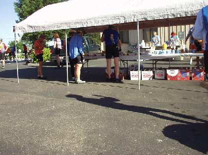 [Mile 19, 8:32 a.m.] More tasty food at the first rest stop: bagels and cream cheese, muffins, cookies, granola, trail mix, strawberries, oranges, melon.  So much variety!