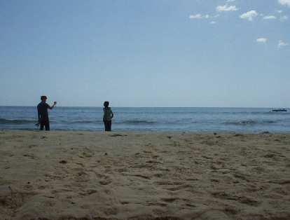 Taking photos on this scenic beach.
