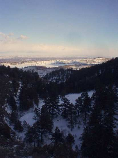 On the Timber Line Trail one can get high enough to look down upon the trees, Horsetooth mountain range, and Fort Collins.
