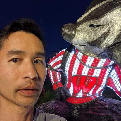 Felix Wong with a University of Wisconsin mascot.