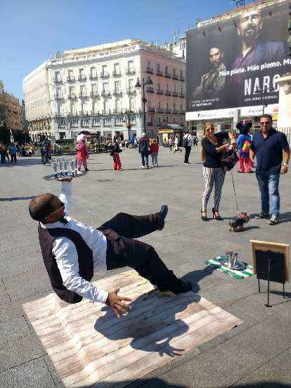 "A ""falling waiter"" stunt at the Puerta del Sol. Netflix's Narcos drama was advertised all over Spain."