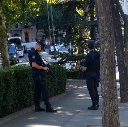 Armed policemen near the Prada Museum.