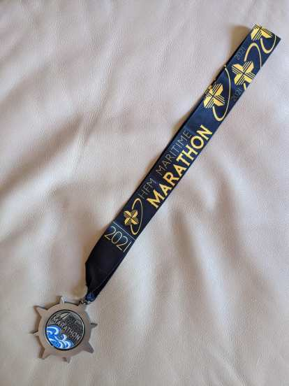 The finisher's medal for the 2021 Maritime Marathon.