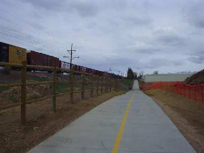 The trail is adjacent to the Burlington Northern Santa Fe Railroad.