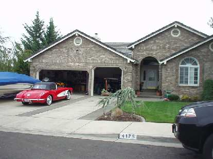 A nice home in east Medford with a vintage Vette in front.