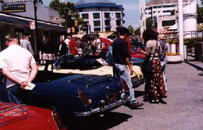 MGB's! MGB's! The well-maintained blue oneis Joe's, and the yellow one, of course,is Goldie. Those people are lookingat her bike rack right now.