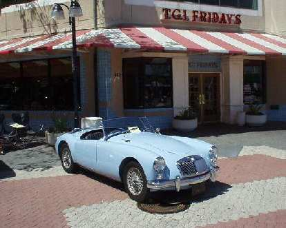 Mike Jacobsen's light blue MGA (again) in front of TGI Fridays.  Looks so appropriate!