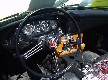 Goldie's interior, featuring the custom wooden center console in which I installed Smiths gauges in January 1997.