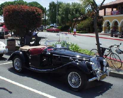 A shiny black MG TF..