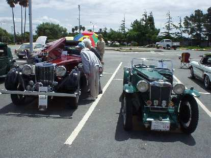 On the left is Terry Sanders imposing 1937 SA drophead coupe (