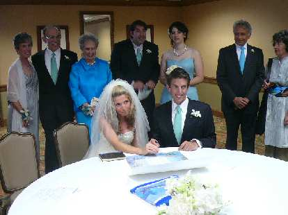 Susan and Dan sign off on the Katouba (a legal Jewish marriage document).