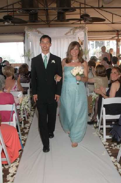 Felix Wong walking down the aisle with Patti, one of the bridesmaids.