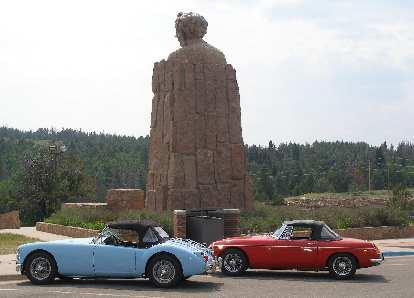 Mike Jacobsen's light blue MGA and Jennifer Orum's red 1970 MGB in front of the Abraham Lincoln Memorial Monument east of Laramie, Wyoming.