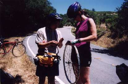 Oh no.  One mile from our destination, Memorial Park, Loren gets a flat.  Here we are trying to repair the torn rim tape with... bandages!