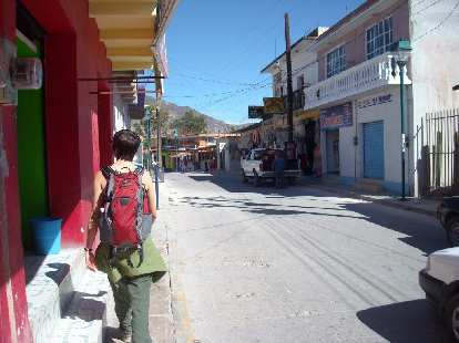 Sarah walking down the main street in Mitla.