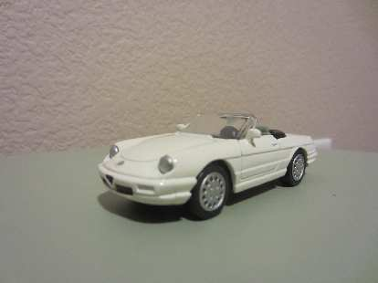 I also found this Alfa Romeo Spider Veloce off ebay.  It was white, but I had just enough custom green spray paint (exact color) that I had formerly used as touchup paint for my Alfa.