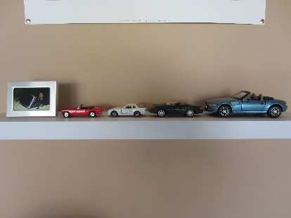 The models of cars I had, now on a shelf in the garage.  I still need one to represent Goldie, my 1969 pale primrose MGB.  I also don't have an Audi TT model, but I have the real thing in the garage!