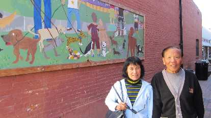 Mom and Dad in front of a doggie mural around the corner from Wagz in Old Town.