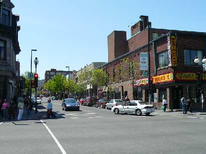 The area east of Mont-Royal (Le Plateau) has lots of shops and restaurants.  Unfortunately I only saw a couple hippies on this day.