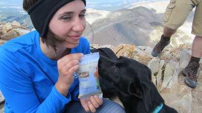 Diana showing Dani a bag of snacks.