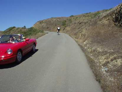[Mile 128, 2:44 p.m.] Here we go, up Coleman Rd!  It probably gets up to 13-14% grade in some sections, and is moderately long.  Seeing this beautiful Alfa Romeo Spider (just like Elaina but in Alfa red) come on down lifted my spirits.