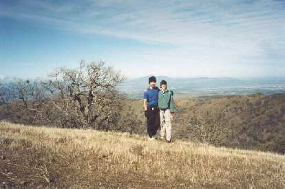 Felix Wong and Sarah on Rose Peak, the highest summit in Alameda County, with Mt. Diablo in the background, the highest summit in Contra Costa County!
